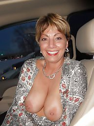 Cute milf flashes boobs