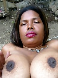 Mature ebony tits